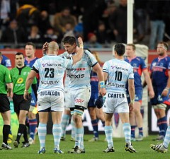 Racing Metro players celebrate victory over Grenoble
