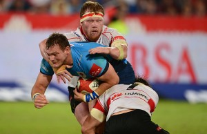 Jacques van Rooyen of the Lions tackles Roelof Smit of the Blue Bulls