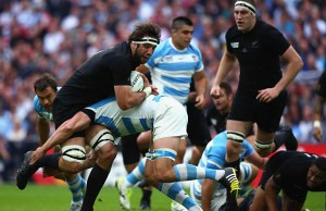 Sam Whitelock gets pushed back in the tackle