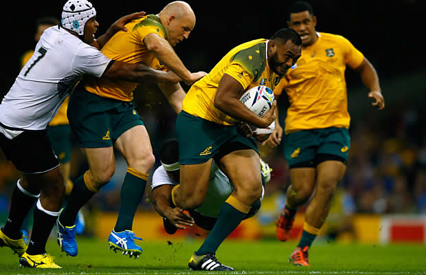 Sekope Kepu makes a break towards the tryline for Australia