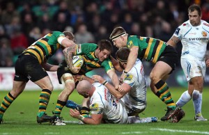 Teimana Harrison of Northampton is tackled by Geoff Parling and Jack Yeandle
