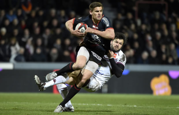 Toby Flood is tackled by Adam Ashley Cooper
