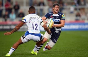 Tom Brady looks to move the ball for Sale Sharks