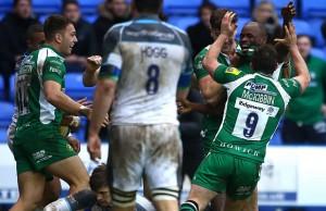 Topsy Ojo celebrates a try for London Irish
