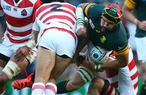 Japan hooker Shota Horie tackles Springbok lock Victor Matfield