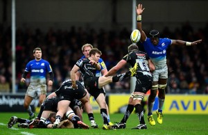 Maro Itoje charges down Will Chudley's clearance kick